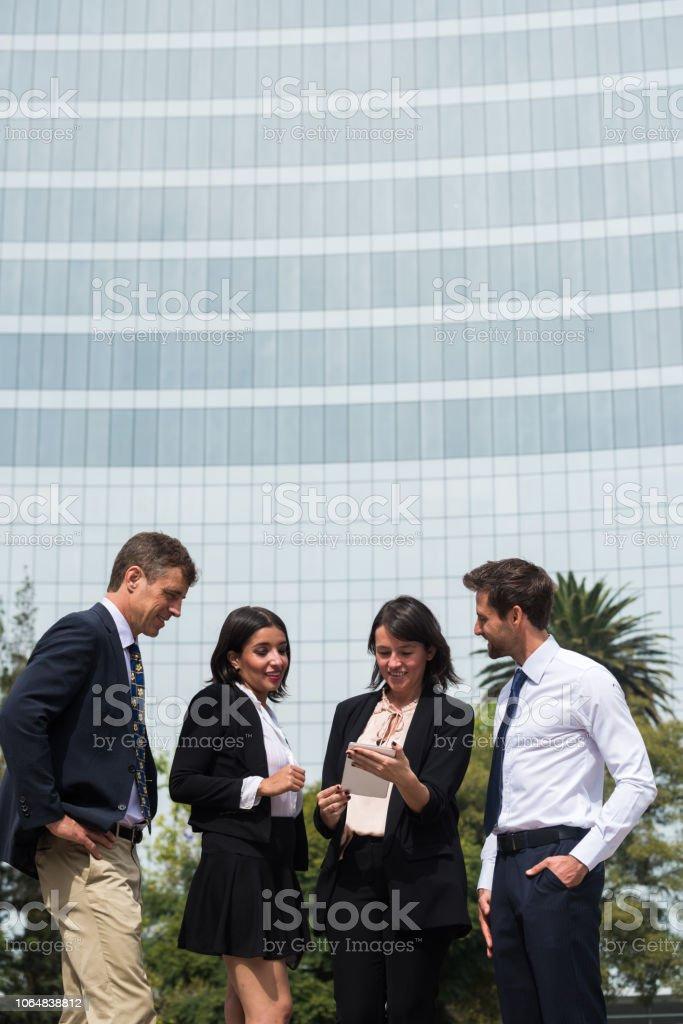 Latin American business team having an outdoor meeting