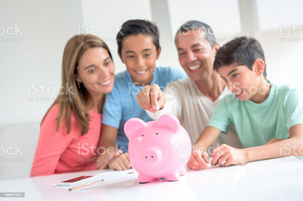 Latin American family saving money stock photo