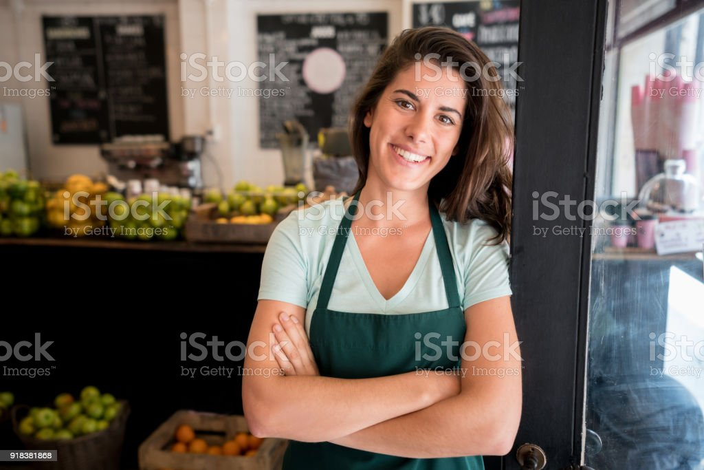 Latin American Female Business Owner At Her Juice Bar
