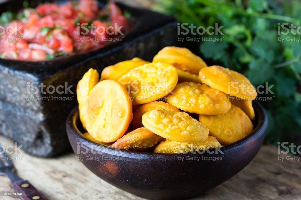 Latin American food. Traditional chilenian homemade pumpkin sopaipillas with salsa stock photo