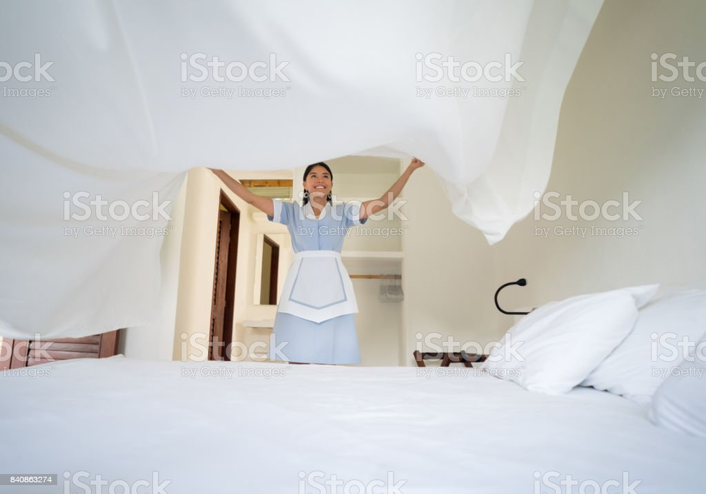 Latin American maid working at a hotel stock photo