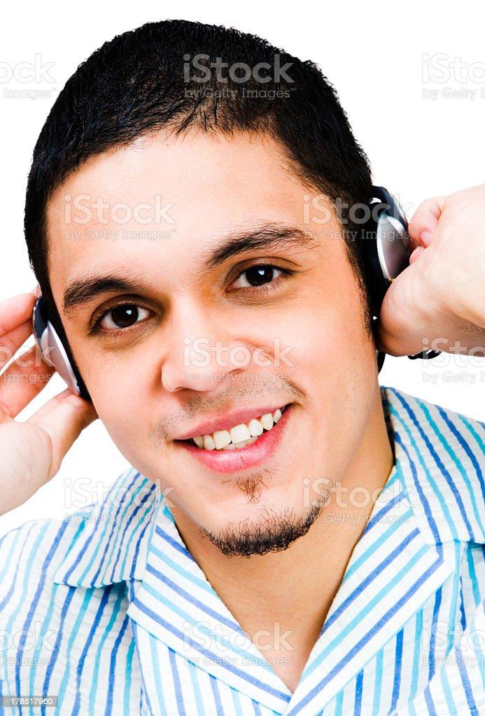 Latin American Man Listening To Headphones royalty-free stock photo