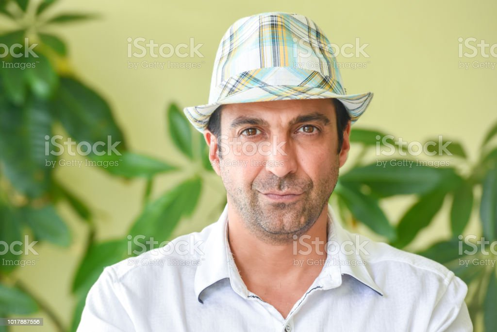 e3cdc22c671 Latin American Man Looking At The Camera Wearing A Hat Stock Photo ...