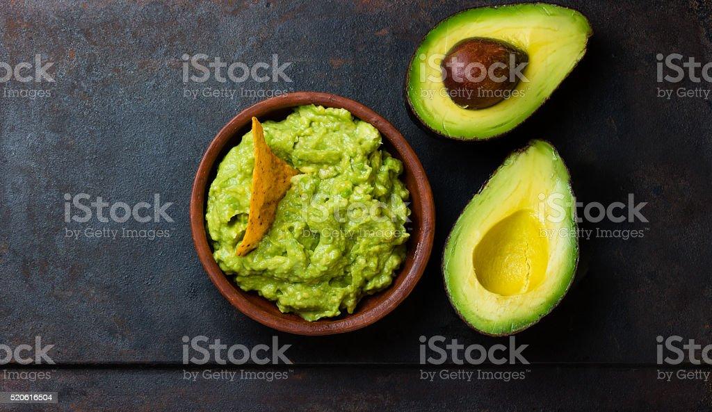 Latin American sauce guacamole and avocado sandwiches on dark background. stock photo