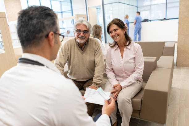 latin american senior patients listening to friendly doctor while he holds a prescription and meds - prescription meds stock pictures, royalty-free photos & images