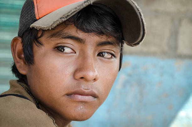 Latin American teen Great glance portrait from a young boy in the southern border of Mexico immigrant stock pictures, royalty-free photos & images