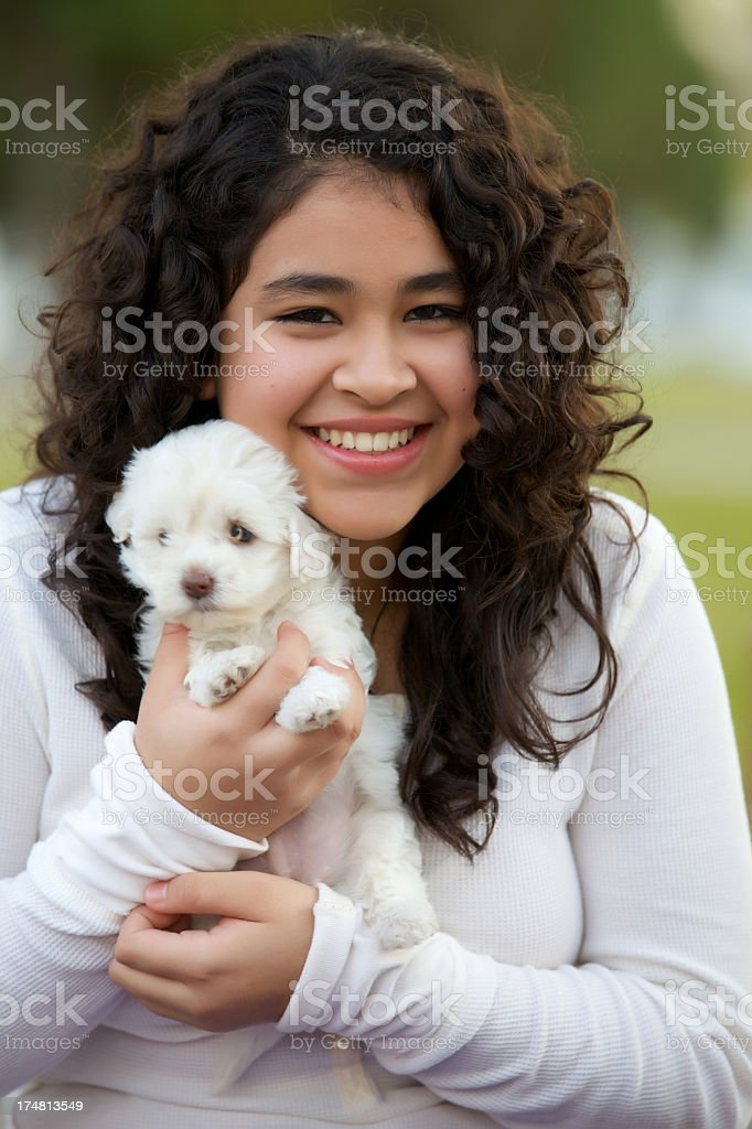 Latin american teenager with her puppy royalty-free stock photo