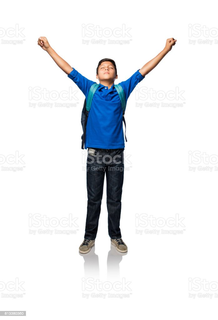 Latin boy standing and raising his arms stock photo