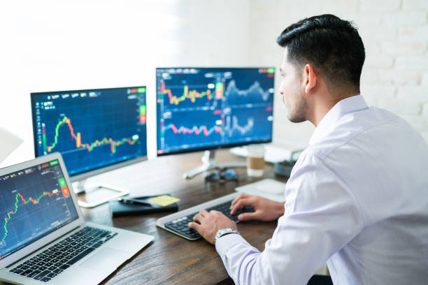 Latin Broker Buying Shares Online Hispanic young male stock trader typing on keyboard while using computer at home seller stock pictures, royalty-free photos & images