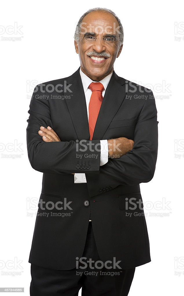 Latin business executive smiling with arms crossed stock photo