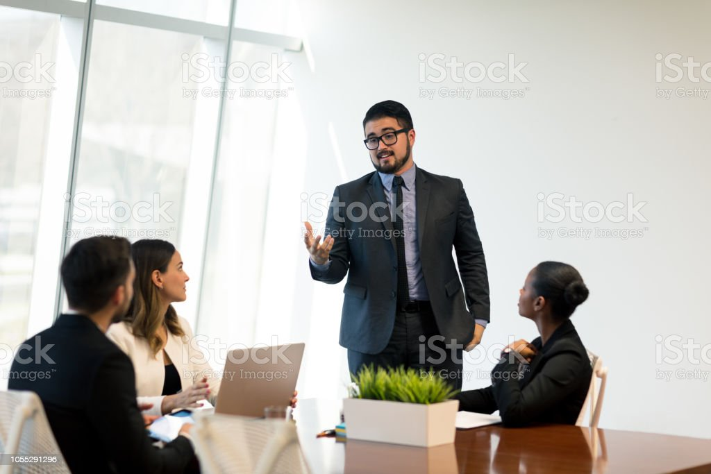Latin business executive talking in meeting stock photo