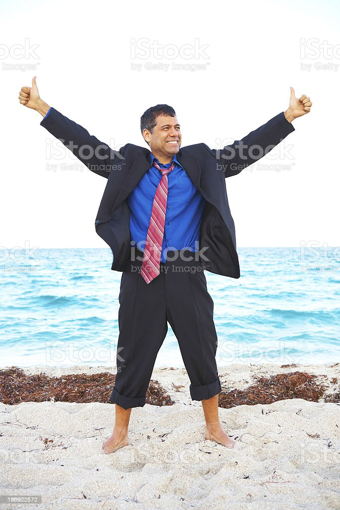 Latin business male enjoying success at the beach stock photo