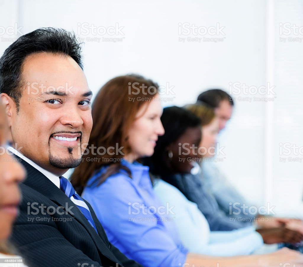Latin business man in training class. College computer lab. stock photo