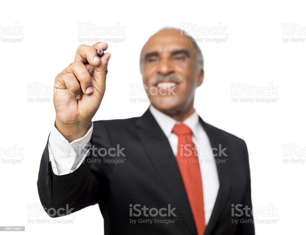 Latin business man writing on a imaginary board royalty-free stock photo
