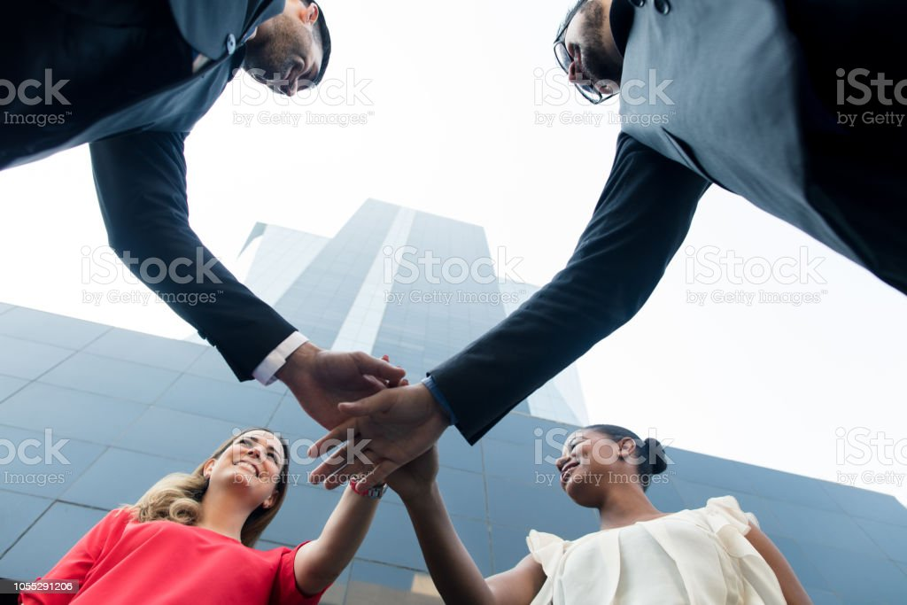 Latin business team grouping in front of building stock photo