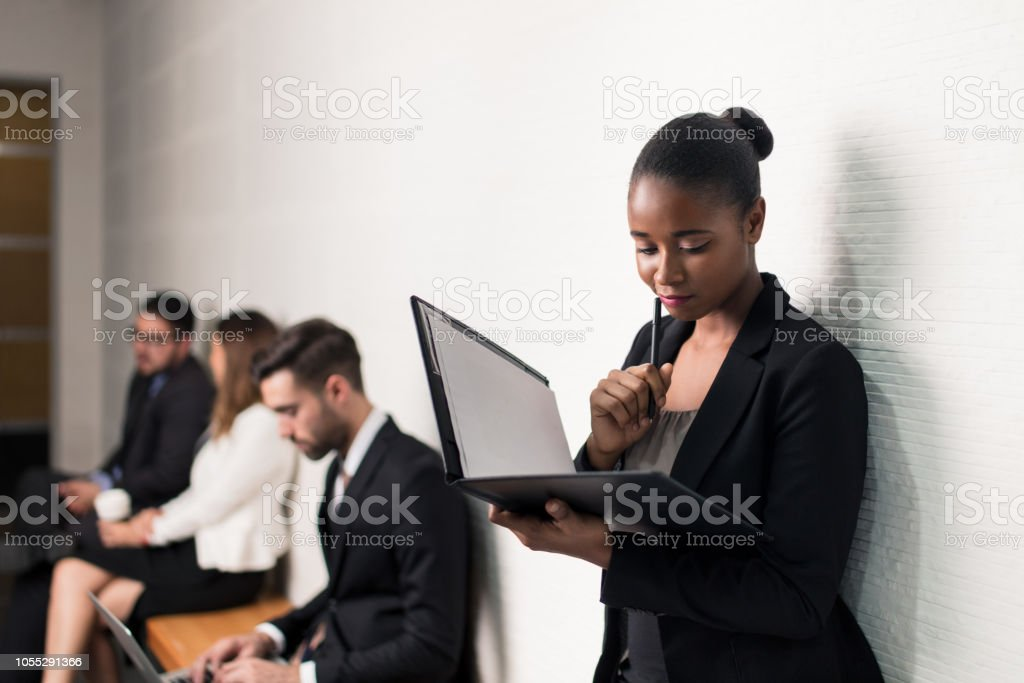 Latin business woman concentrated on her portfolio stock photo