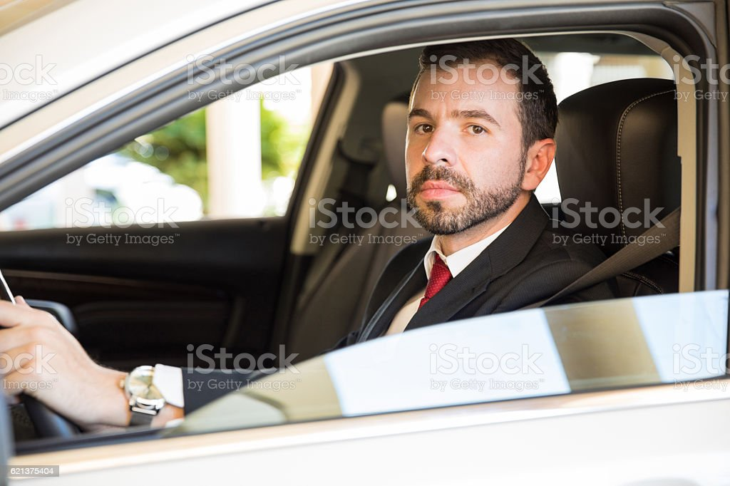 Latin businessman driving a car stock photo