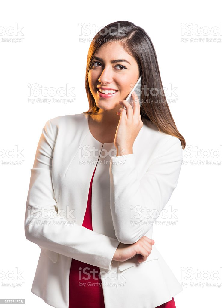 Latin businesswoman using phone and smiling away - foto de stock