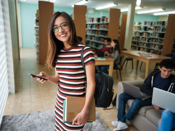 Latin college girl with phone stock photo