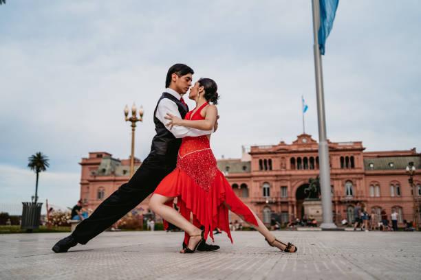 Latin couple dancing tango on town square stock photo
