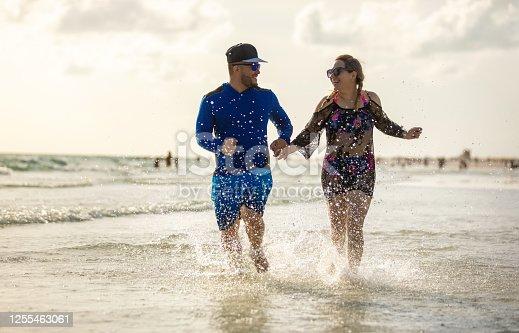 Latin couple having fun on the beach