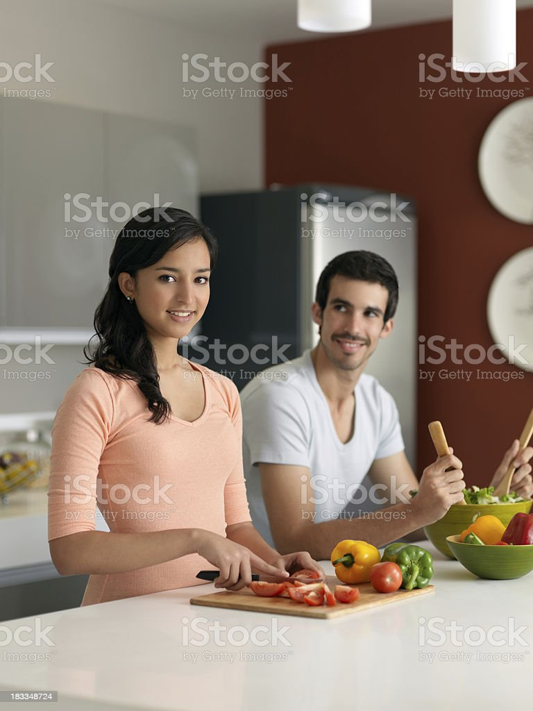 Latin couple preparing some food royalty-free stock photo
