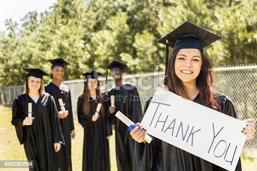 istock Latin descent college, high school student holds