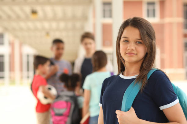 Latin descent, high school age girl on school campus. stock photo