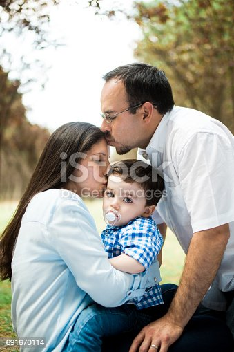 811227514 istock photo Latin family kissing each other on forehead 691670114