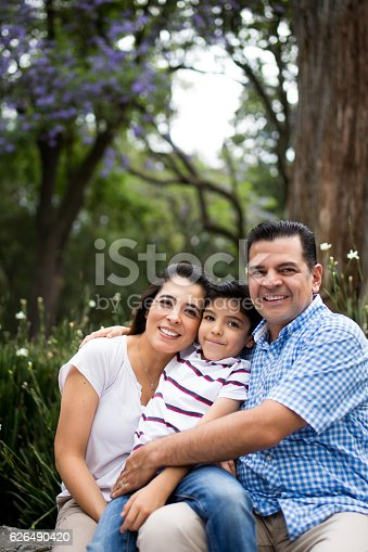 811227514 istock photo Latin family with one child smiling at the camera 626490420