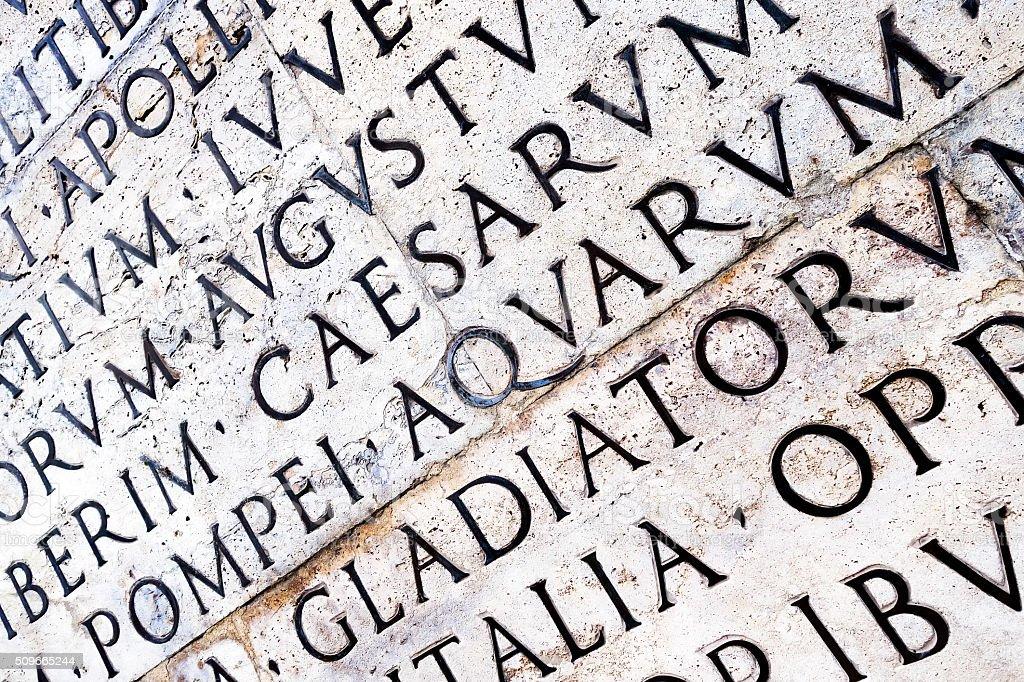 Latin inscription on Ara Pacis wall in Rome, Italy stock photo