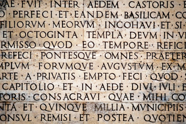 Latin inscription on the outside wall of Ara Pacis wall in Rome, Italy stock photo