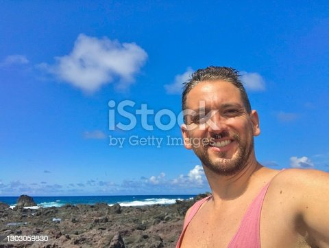 istock A latin male backpacker tourist taking a journey around Esater Island, Chile, Latin America 1303059830