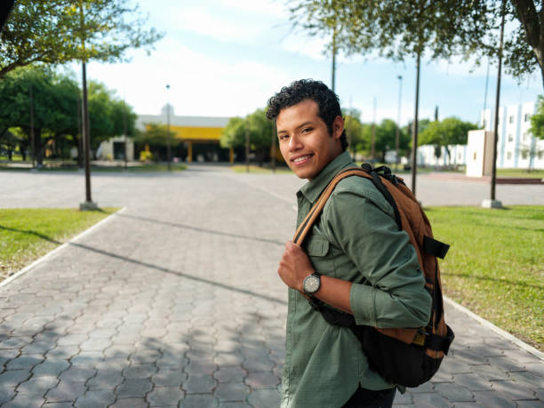 Latin male student with backpack stock photo