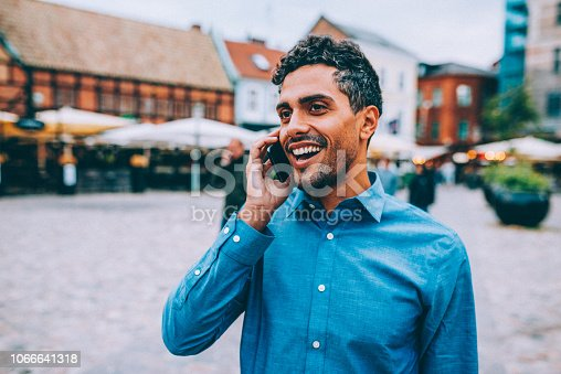 Portrait of Latin - Brazilian adult handsome man living in Sweden and going to and back from work. City life concept