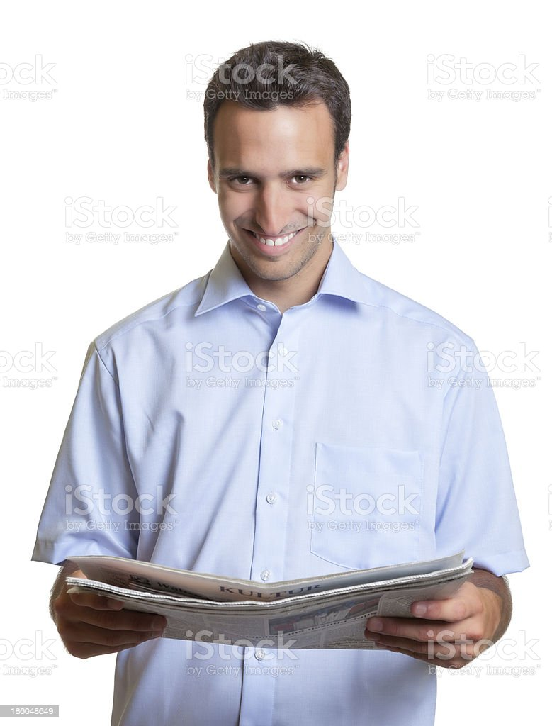 Latin man reading newspaper royalty-free stock photo