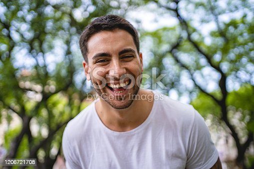 492529287istockphoto Latin man smiling at the camera portrait 1206721708