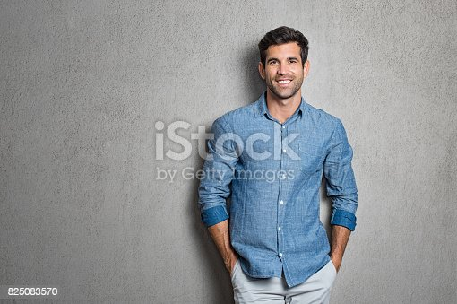 istock Latin man standing 825083570