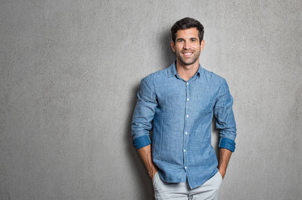 latin man standing - handsome people stock photos and pictures