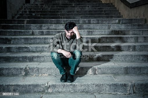 Latin Man Stressed From Work Sitting On Steps Outside Feeling Anxiety In Adult Cause Of Depression And Problem In Living That Makes You Feel Lonely Sad And Worried In Mental Health Concept Stock Photo & More Pictures of Addiction