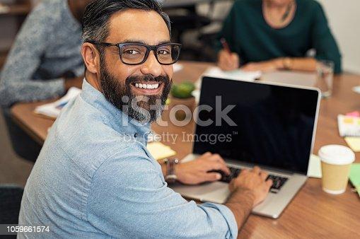 istock Latin mature businessman working on laptop 1059661574