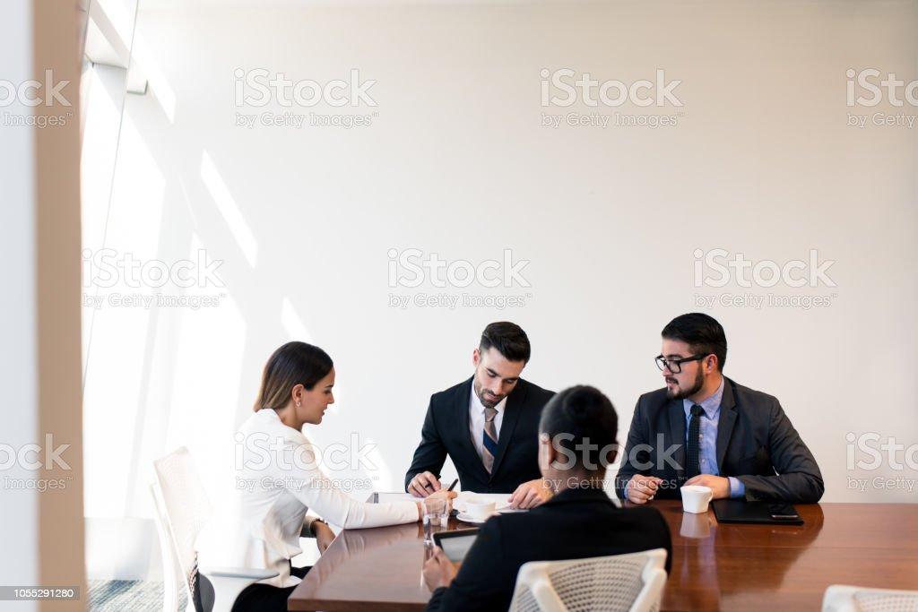 Latin millennial executives in a meeting stock photo