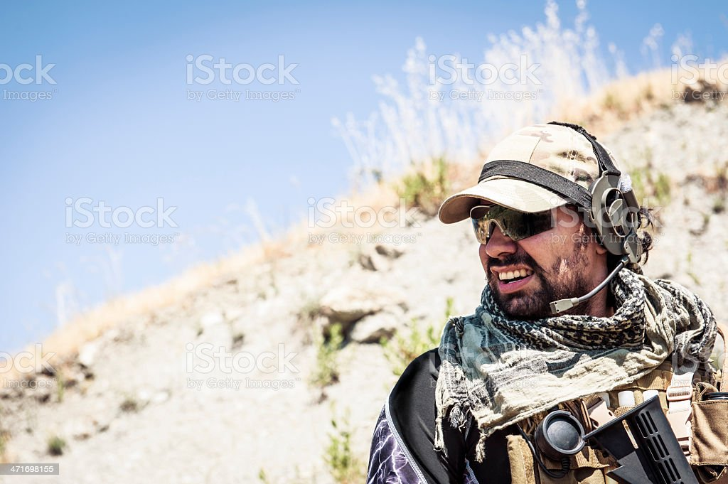 Latin Modern Contractor Soldier Looks Tired and Worried stock photo