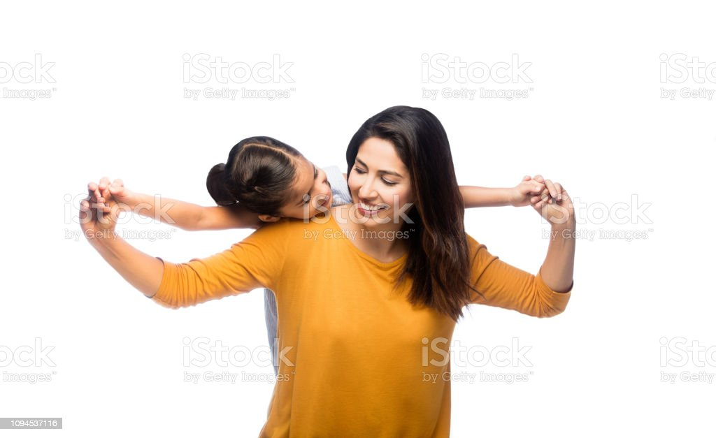 Latin mother and daughter looking at each other stock photo