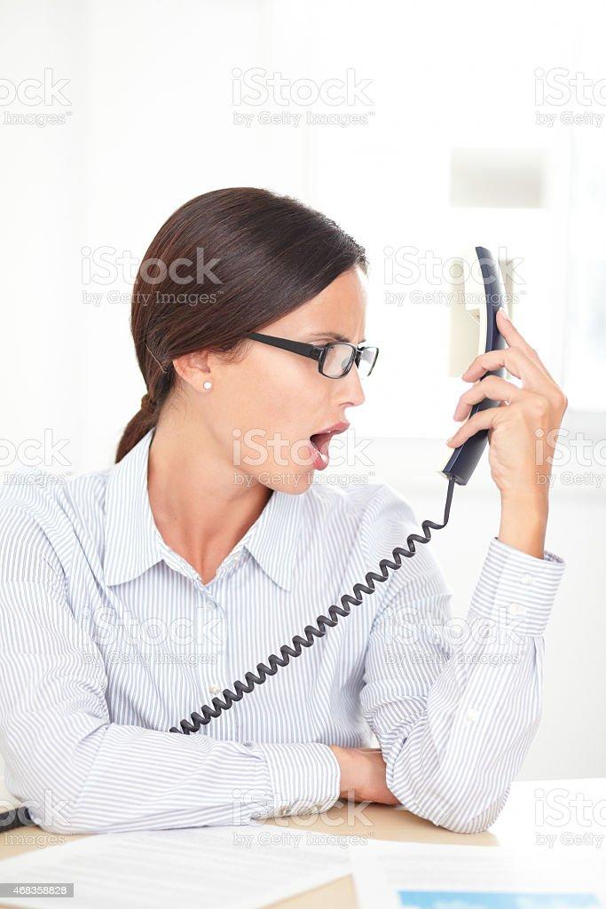 Latin professional employee screaming on the phone stock photo