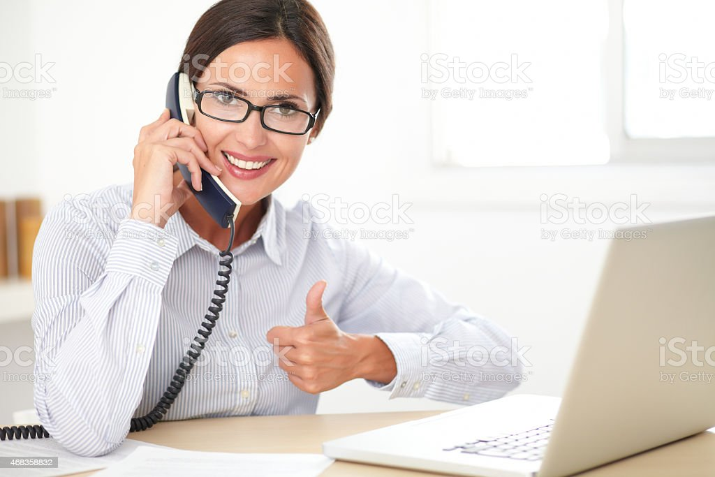 Latin receptionist talking on the phone royalty-free stock photo