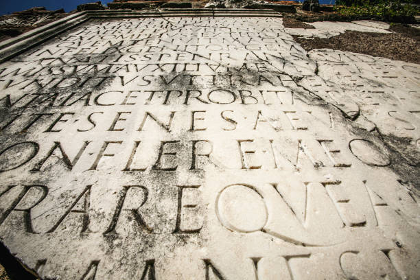 Latin script carved in marble in Rome stock photo