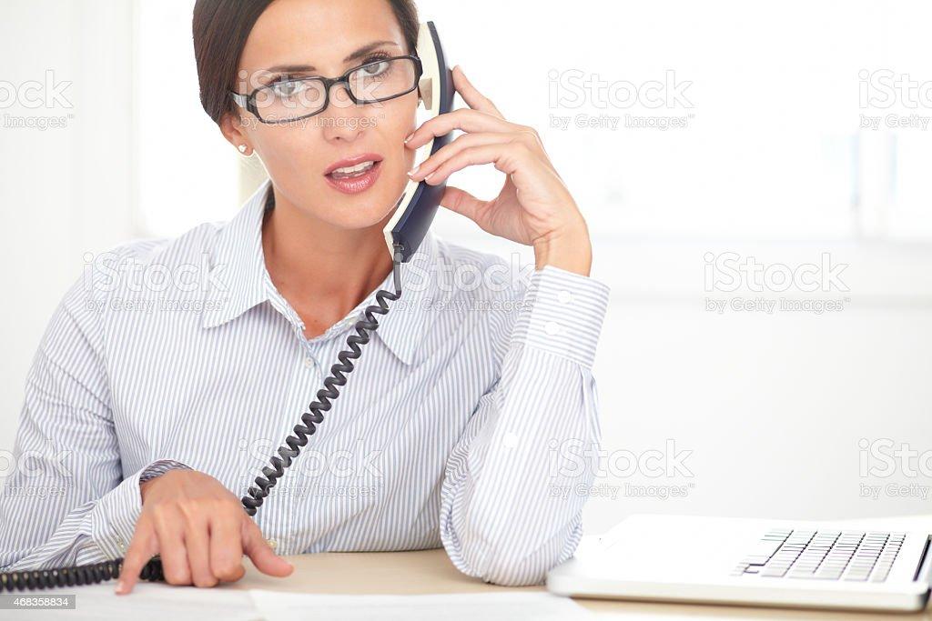 Latin secretary doing customer service in office royalty-free stock photo