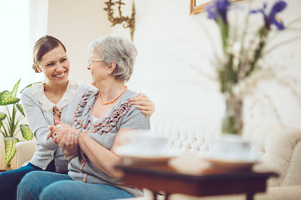 Latin social worker is visiting a senior woman stock photo