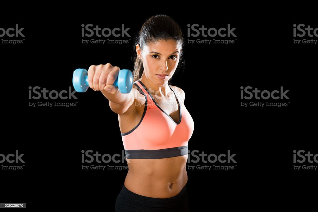 latin sport woman posing in fierce and badass face expression stock photo